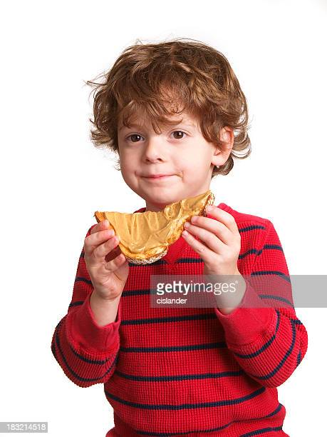 Boy eating peanut butter