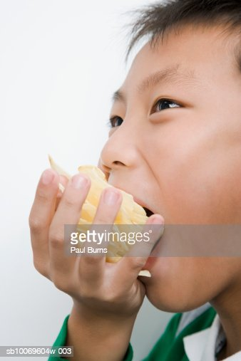 Boy (10-11) eating potato chips : Stock Photo