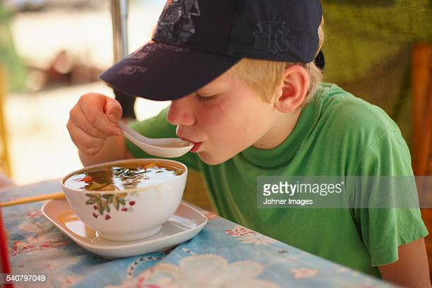 Boy eating soup