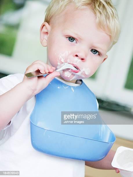 Boy eating yoghurt