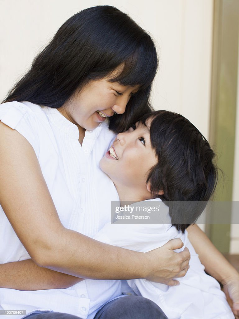Boy (8-9) embracing mother : Stock Photo