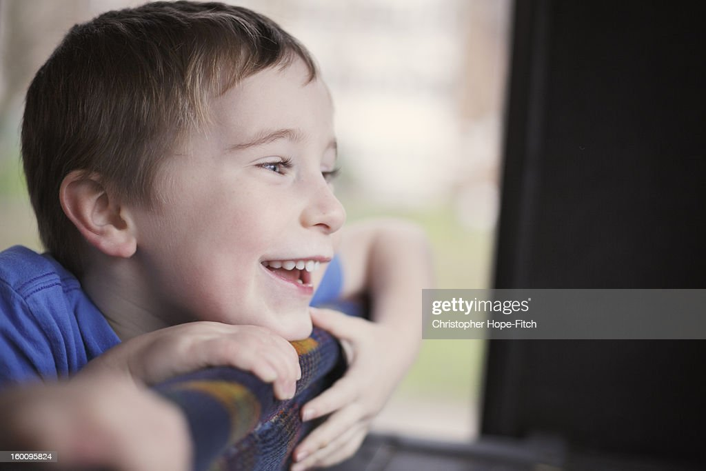 Boy enjoying a bus journey : Stock Photo