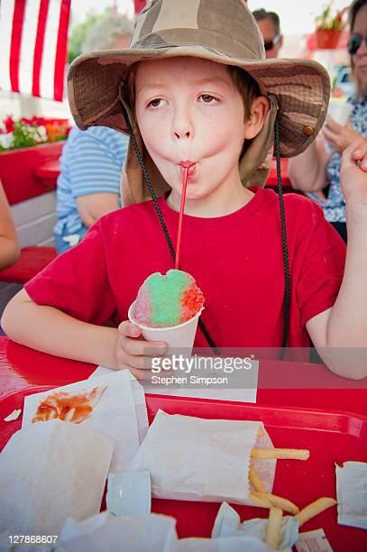 boy enjoying a snow cone [shaved ice]