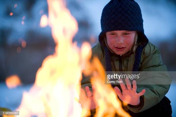 A boy enjoys a campfire while in the backcountry of California.