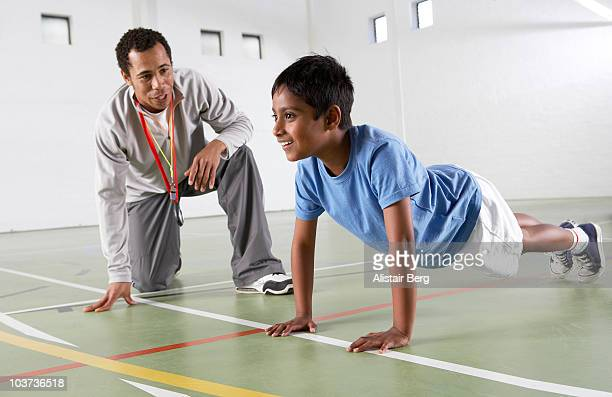 Boy exercising in gymnasium