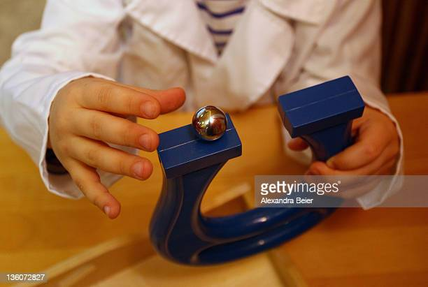 A boy experiments with a magnetic ball at a day care center for children aged 12 months to six years on December 22 2011 in Munich Germany German...