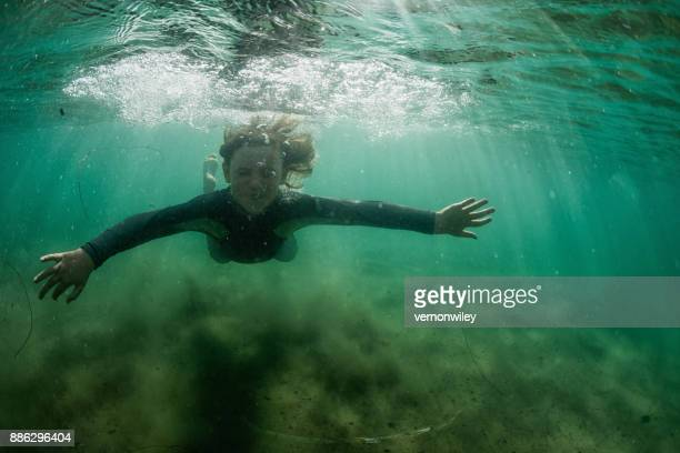 Boy exploring the ocean underwater
