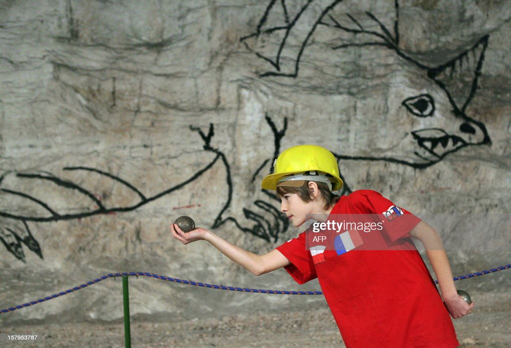 A boy eyes a ball during a pétanque tournament in the Klodawa Salt Mine, western Poland on December 7, 2012. The tournament is taking place in a special tourist part of the salt mine located 600 meters under ground.