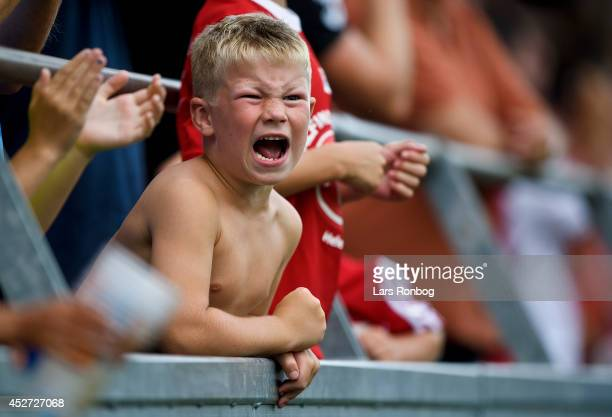 A boy fan of AaB Aalborg cheers after the Danish Superliga match between AaB Aalborg and FC Midtjylland at Nordjyske Arena on July 26 2014 in Aalborg...
