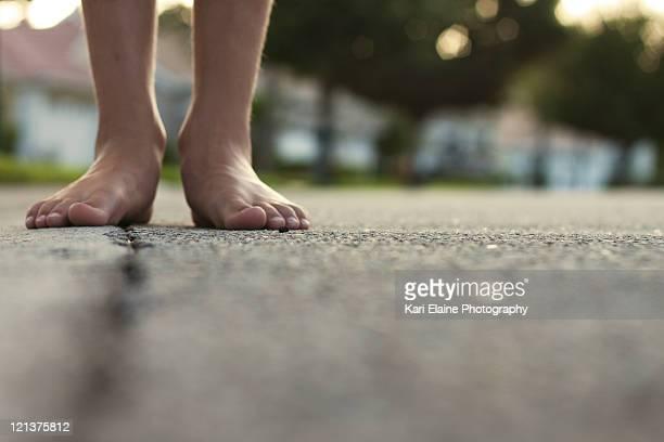 Boy feet on street pavement