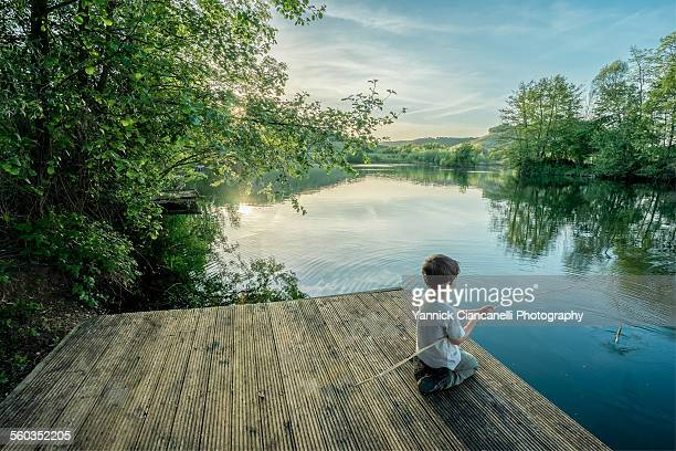 Boy Fishing In A Pond