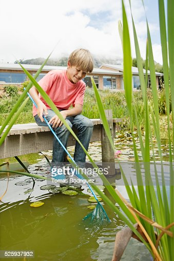 Boy (6-7) fishing on pier : Stock Photo