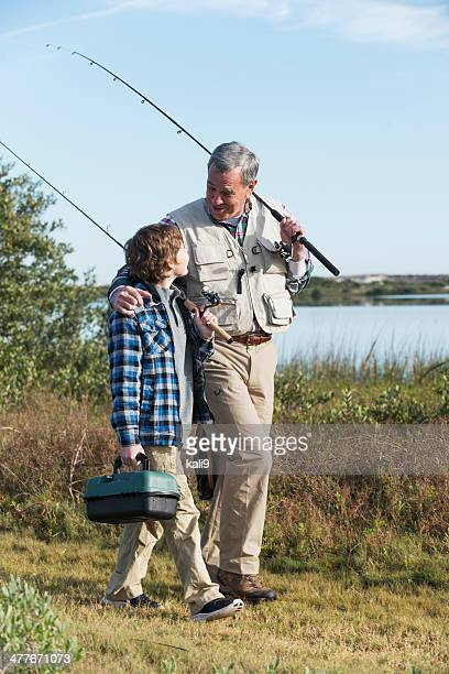 Boy fishing with grandfather