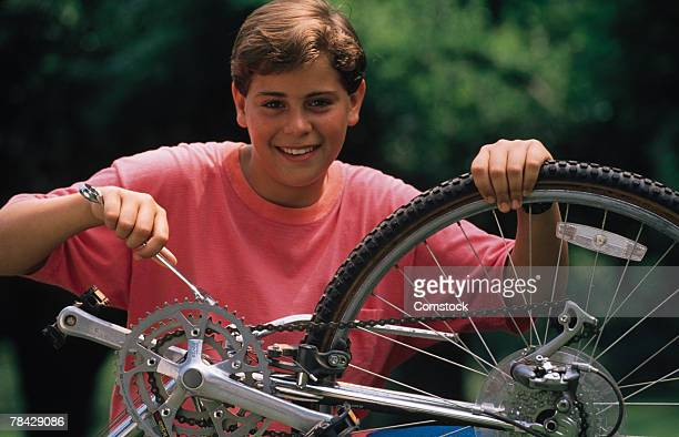 Boy fixing a bicycle