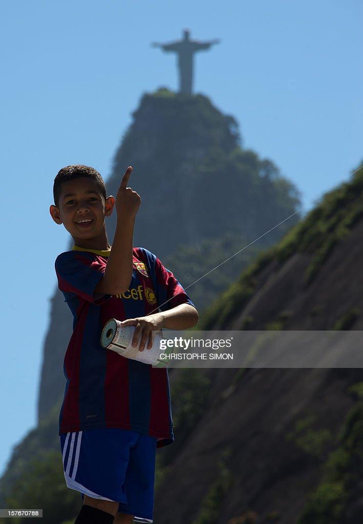 A boy flies a kite in Santa Marta slum in Rio de Janeiro, Brazil, on December 5, 2012.