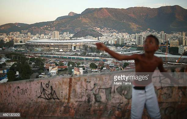 A boy flies a kite in the Mangueira community or 'favela' which overlooks the famed Maracana Stadium on June 5 2014 in Rio de Janeiro Brazil Maracana...