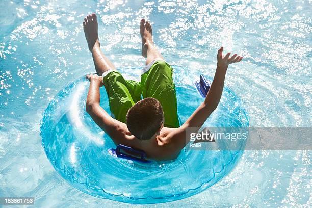 Boy floating on innertube