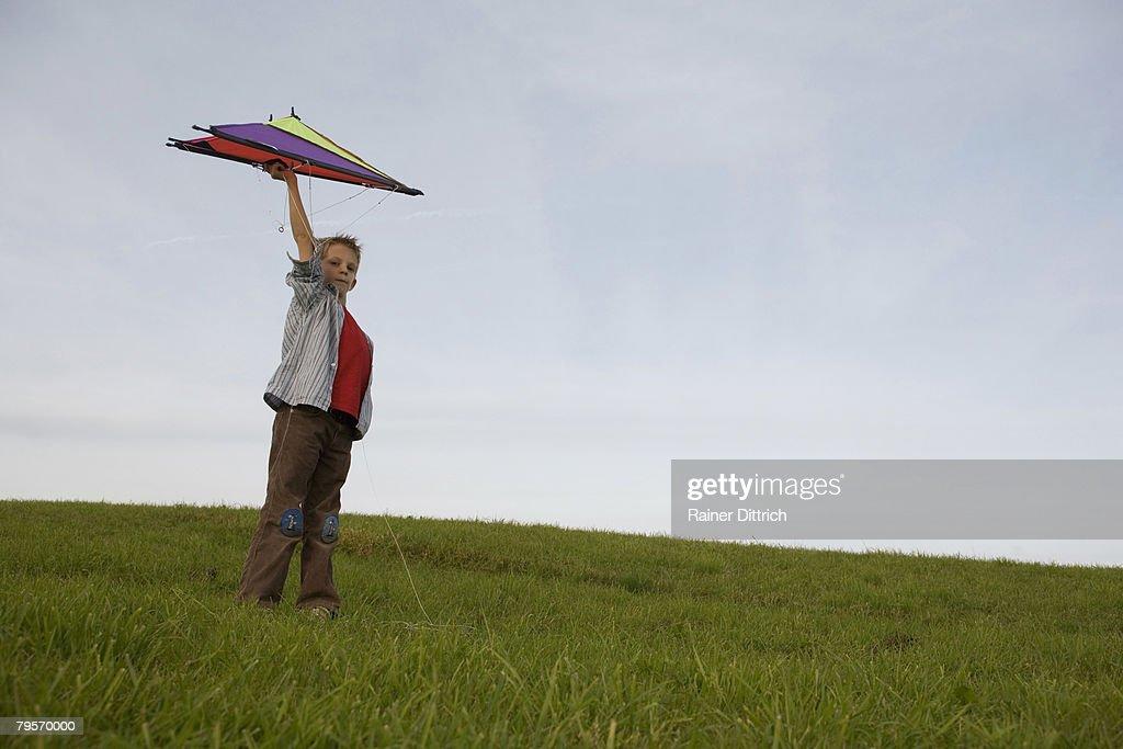 Boy (10-12) flying kite : Stock Photo
