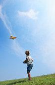 Boy flying model plane