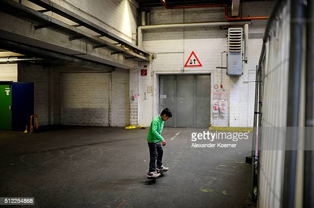 A boy from Afghanistan skates through corridors inside a shelter where they live while their asylum applications are processed on February 25 2016 in...