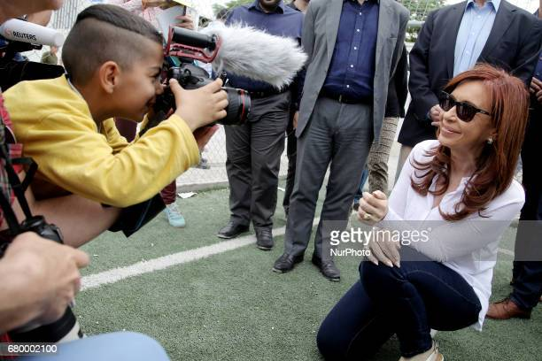 A boy from Afghanistan uses a camera to take a snapshot of former Argentinean president Cristina Fernandez de Kirchner during her visit to the...
