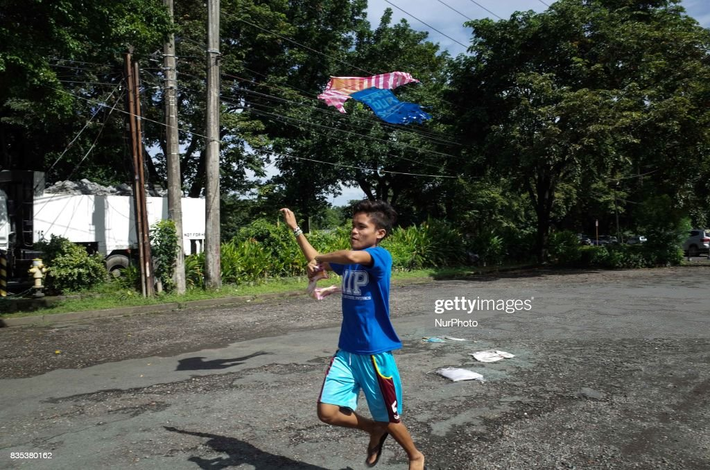 A boy from Mindanao residing at a makeshift school at the University of the Philippines International Center flies a kite in Quezon City on Saturday, August 19, 2017. In a statement, the Save Our Schools Network challenged the National Commission on the Indigenous Peoples (NCIP) to 'support their fellow lumad's aspirations to have a school rather than be a tool for counter-insurgency.' President Rodrigo Duterte has previously stated that he will bomb indigenous peoples' schools, accusing them of teaching rebellion to indigenous children.