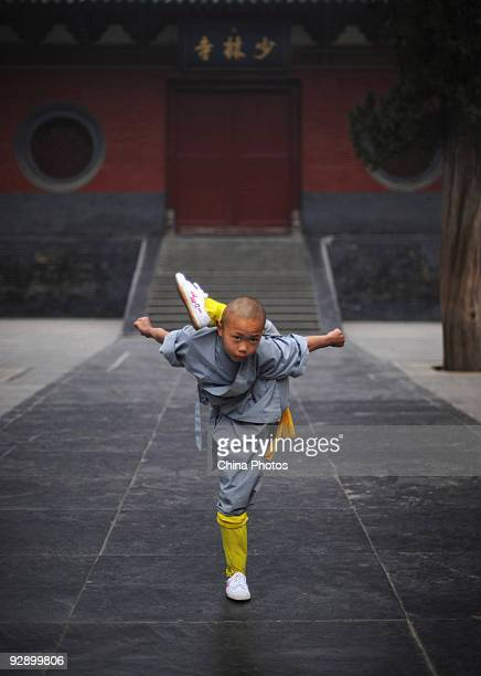 A boy from Shaolin Kung Fu Training Base practices Kung Fu movements at the Shaolin Temple on the Songshan Mountain on October 30 2009 in Dengfeng of...