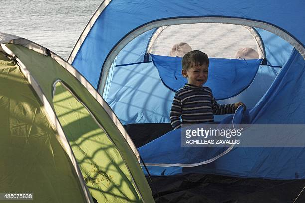 A boy from Syria standing at the entrance of a tent cries and calls for his mother in the port of Mytilene on the Greek Aegean island of Lesbos on...