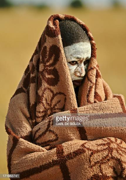A boy from the Xhosa tribe who has undergone a circumcision ceremony is pictured near Qunu on June 28 2013 Qunu is where former South African...