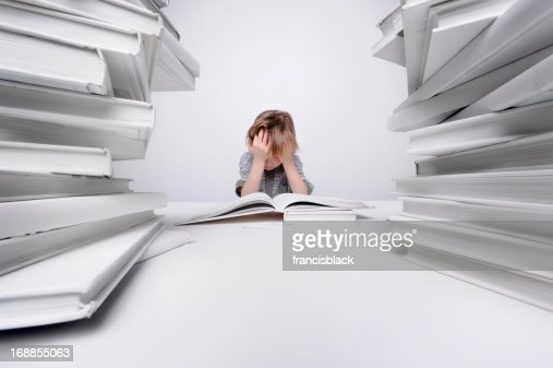 Boy frustrated with homework. : Stock Photo
