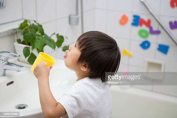 Boy gargling in bathroom