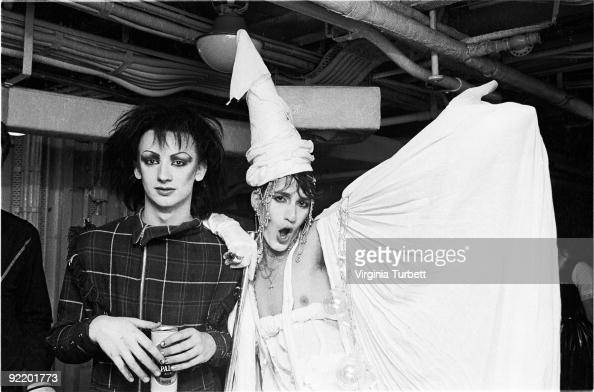 Boy George and a friend with fellow New Romantics watch Spandau Ballet perform live on HMS Belfast on July 26 1980