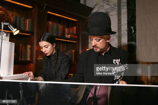 Boy George and Charli XCX pose at the Esquire Party during the London Collections Men AW14 at Rosewood London on January 6 2014 in London England