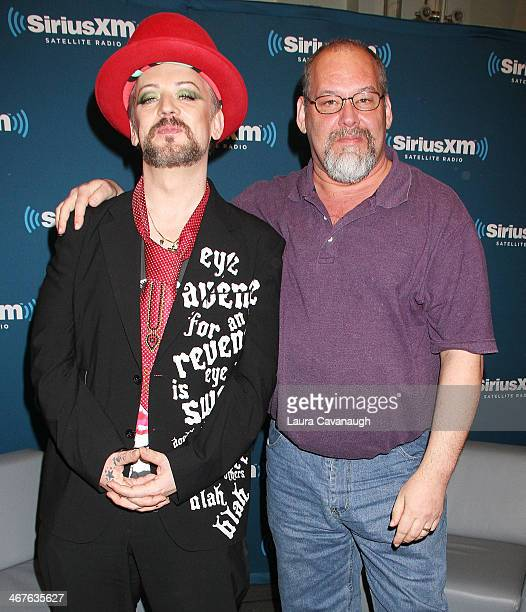 Boy George and Larry Flick attend SiriusXM's 'Iconography Boy George' at SiriusXM Studios on February 7 2014 in New York City