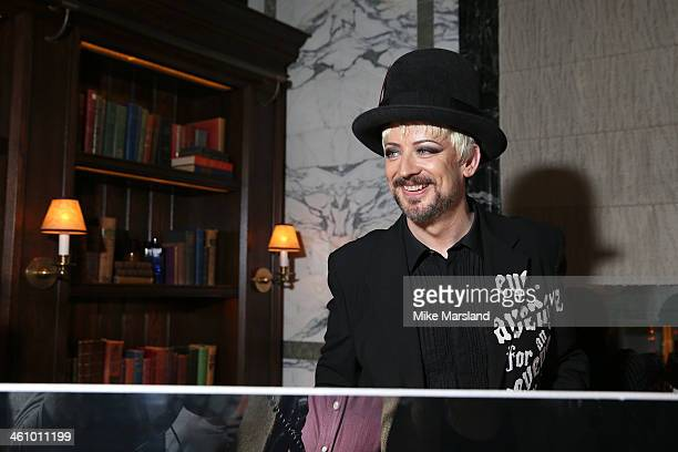 Boy George poses at the Esquire Party during the London Collections Men AW14 at Rosewood London on January 6 2014 in London England