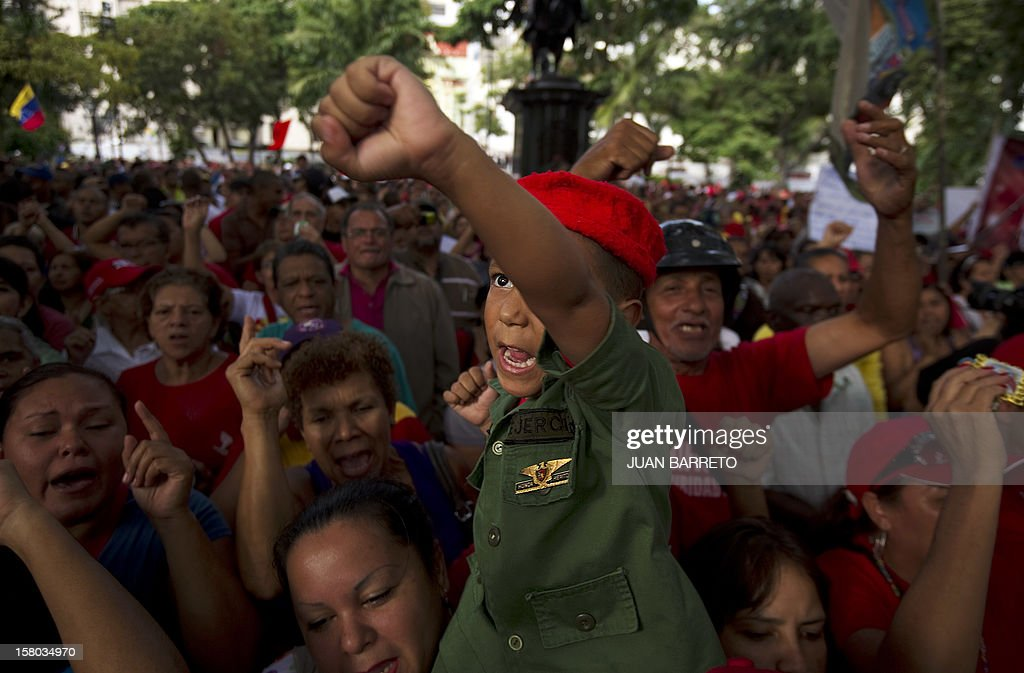 A boy gestures during a rally in support of Venezuelan President Hugo Chavez, in Caracas on December 9, 2012. Chavez was poised to head to Cuba Sunday for more cancer surgery, after speaking for the first time of a successor in this oil-rich nation he so thoroughly dominates should he not recover. Treatment is 'absolutely necessary,' the leftist leader said in a bombshell statement on state television in which he admitted he may have to give up the presidency and that Vice President Nicolas Maduro is his chosen successor. AFP PHOTO