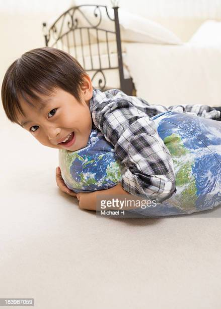 A boy get on the BALLOON of the earth