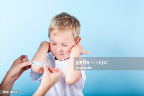 Boy Getting Band-aid