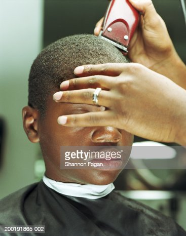 Boy (12-14) getting haircut in barbershop, close-up : Stock Photo
