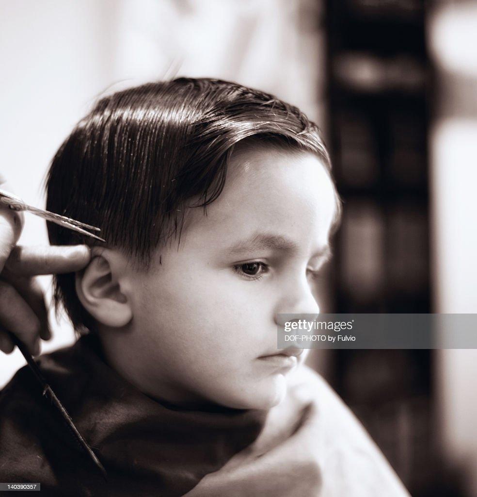Boy getting haircut : Stock Photo