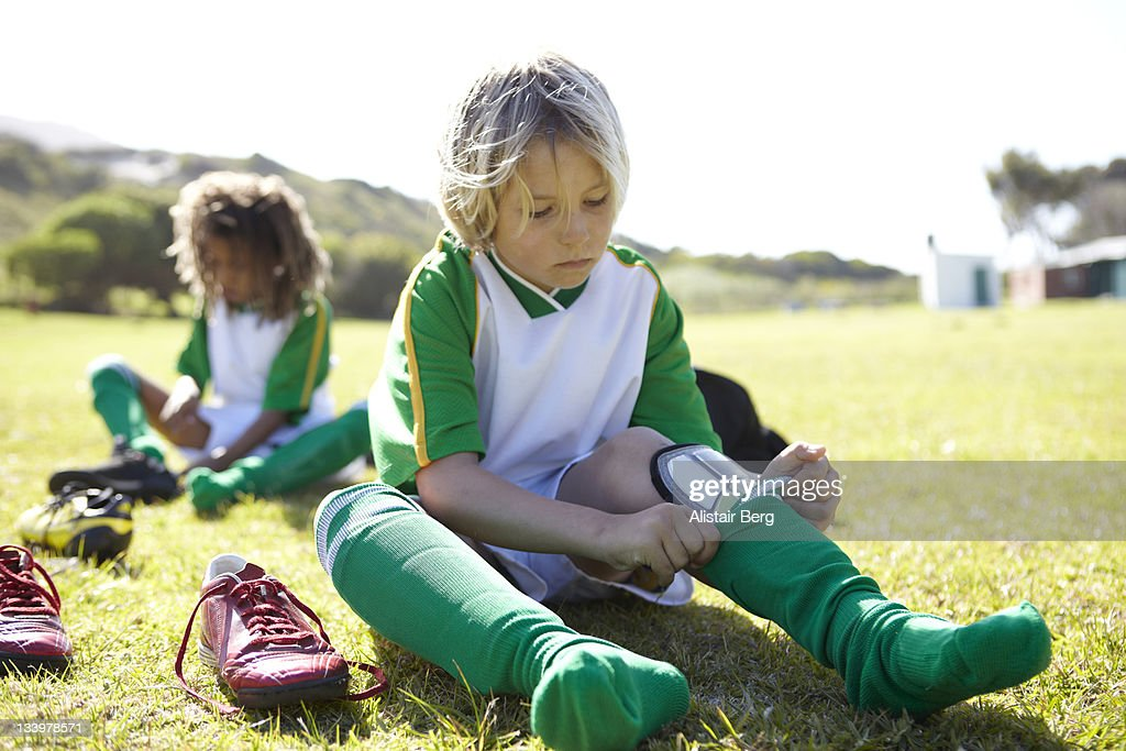 Boy getting ready to play football : Stock Photo