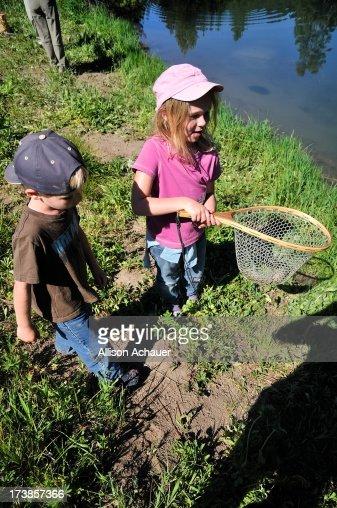 Boy, Girl, and Fish