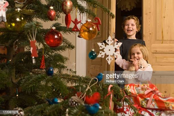 Boy (6 years) Girl (3 years) on Christmas morning