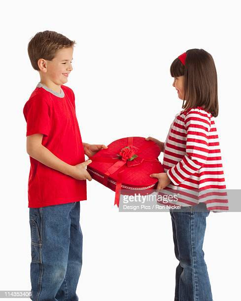 A Boy Gives A Heart Shaped Box To A Girl