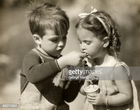 Boy gives ice cream to sister : Stock Photo
