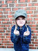 Boy (6-7) giving finger gesture