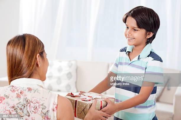 Boy giving gift to his mother on mother's day