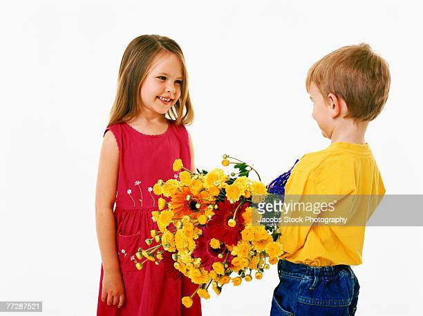 Boy giving girl bouquet of flowers