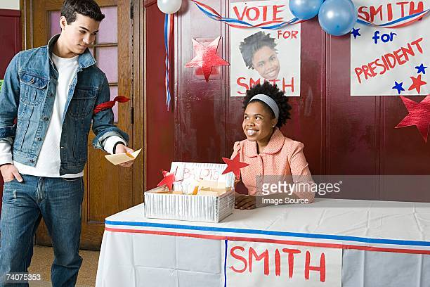 Boy giving his vote to girl
