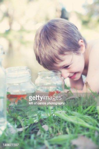 Boy goes fishing : Stock Photo